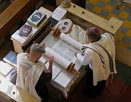 A man and a young man reading the Torah together