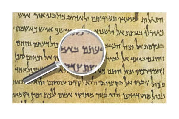 The Community Rule Dead Sea Scroll Text first page snippet with a magnifying glass in front